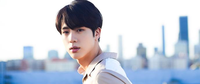 Quem é Jin? O Mr. Worldwide Handsome tem talento de tirar o fôlego